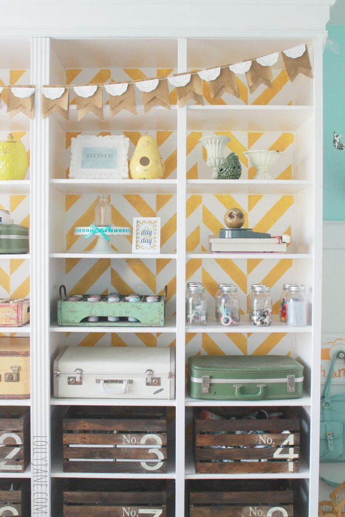 Herringbone stenciled bookcase, fill with vintage goods for storage #organization #craftroo