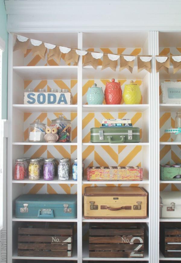 herringbone-bookcase-decorate-with-vintage-goods-as-storage