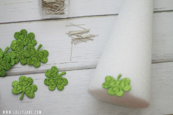 So easy to make a St Patricks shamrock tree, just pin felt stickers to styrofoam trees! #stpatricksdaycraft #shamrockcraft