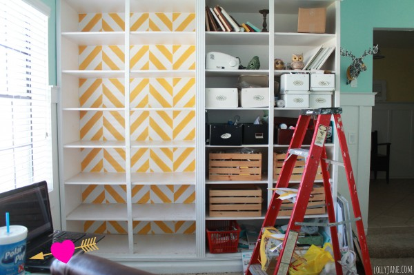 painting-a-herringbone-bookcase-stencil-during-picture