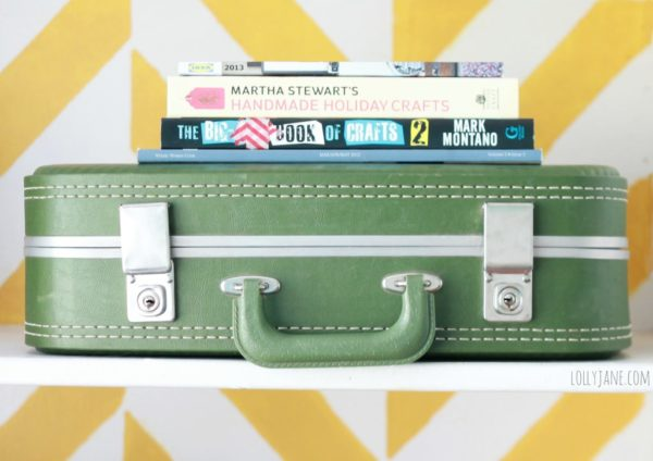 Love using vintage suitcases as storage in a craft room!