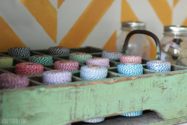 Vintage crate for the craft room, perfect size to hold bakers twine! #organization #craftroom