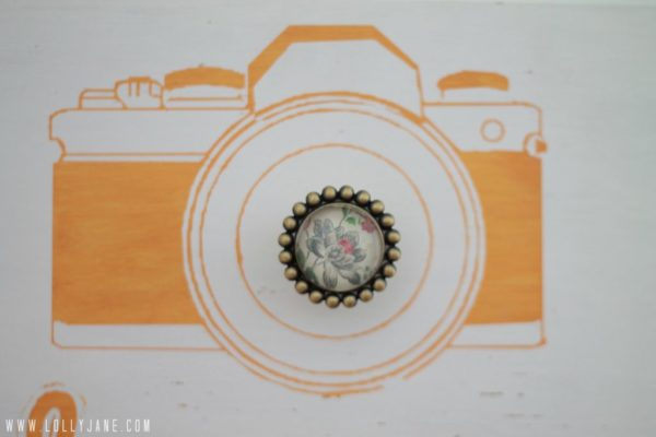 Hand painted camera with a cute knob makes a great camera bag holder #organization #lollyjane