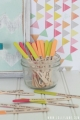 Write ideas on popsicle sticks for boredom buster, color sticks according to themes: outdoor, indoor, away from home.