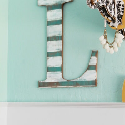 Distressed striped wall letter