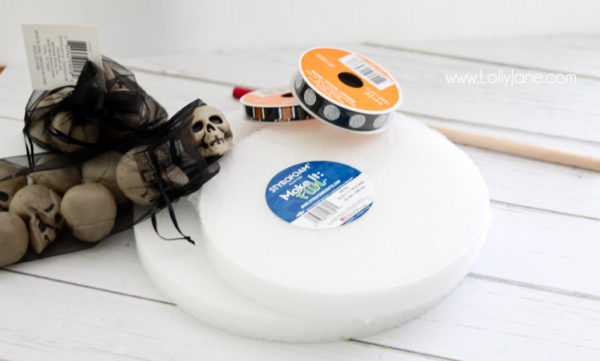 Supplies to make a cute Halloween skull cake stand