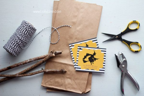 Supplies to make some cute witch broomstick Halloween treat bags!