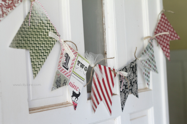 Easy scrapbook paper banner Christmas bunting via www.lollyjane.com
