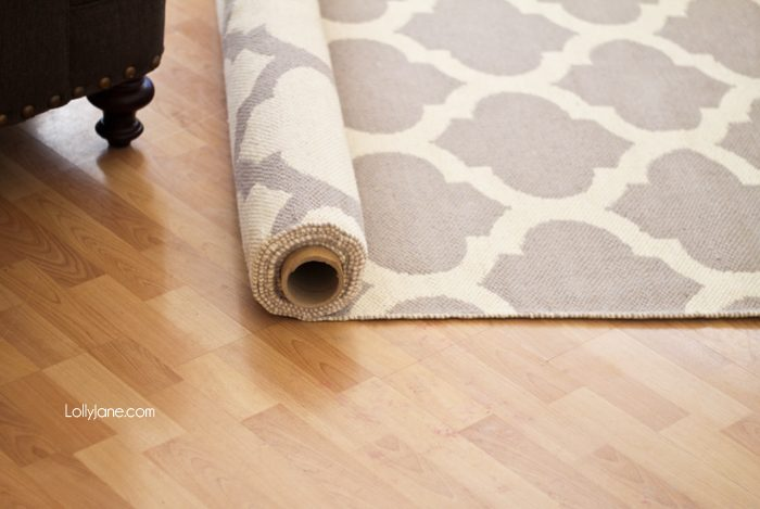 5 tips for decorating with rugs for Can you put an area rug on carpet