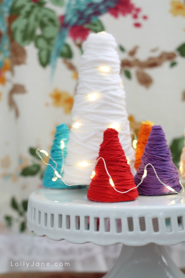 Yarn wrapped trees! Great for party decor, would be a fun centerpiece! Love the different colors and the wrapped lights! (lollyjane.com)