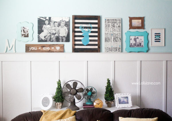 Cute gallery wall in mustards & turquoise! LOVE that striped deer head sign!
