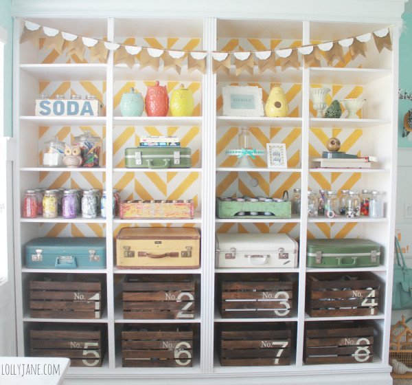Cool herringbone stenciled bookcase in a cute craft room  via lollyane.com