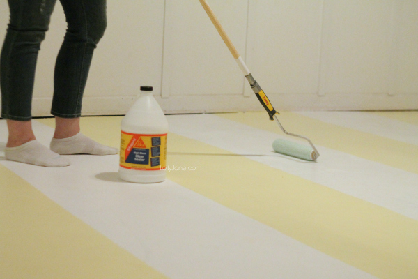 How to seal concrete, roll on cement sealer and let it dry overnight.
