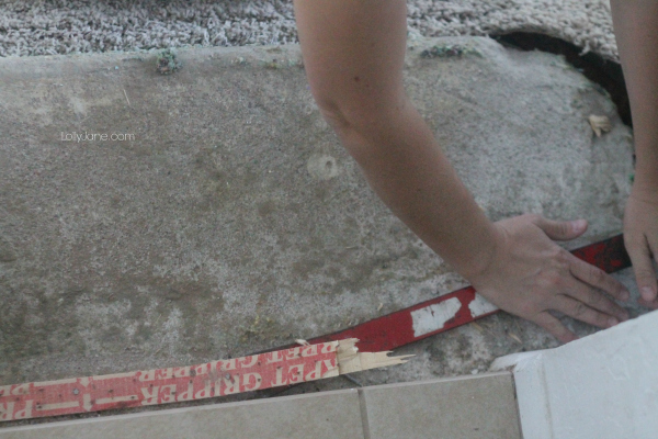 How to rip out carpet: use a crowbar to lift carpet tacks, pry from the middle.