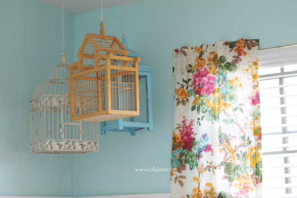 Hang some colorful bird cages in an eclectic craft room! @lollyjaneblog