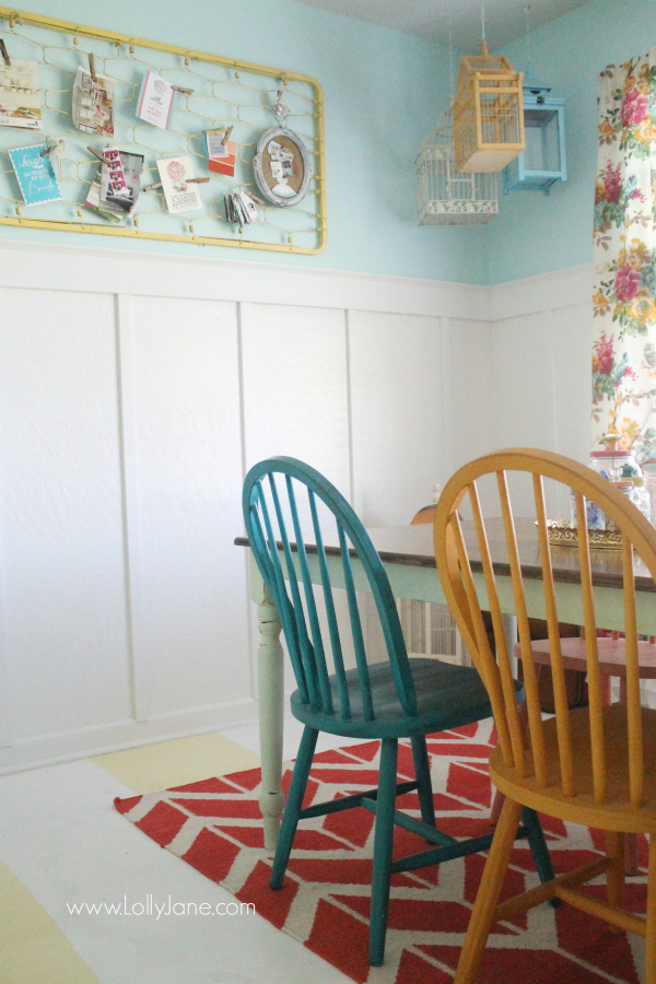 Use an old painted crib spring for easy wall decor in a colorful craft room! @lollyjaneblog