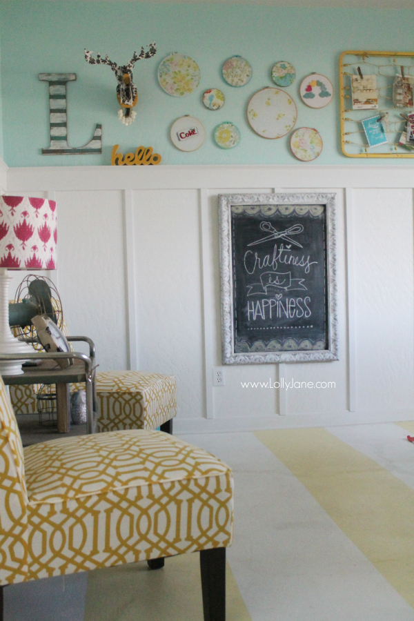"Fun ""Happiness is Craftiness"" chalkboard in a cute, colorful craft room!"