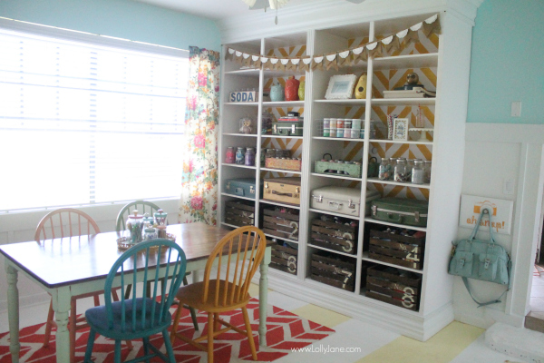 Lolly Jane's fun herringbone bookcase in their craft room! Love this space! @lollyjaneblog