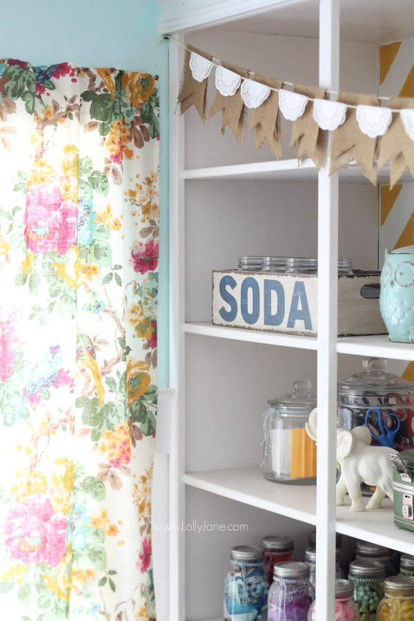 Quick tip to hang a faux curtain without a rod? Upholstery tacks!! Looks great in this craft room! @lollyjaneblog