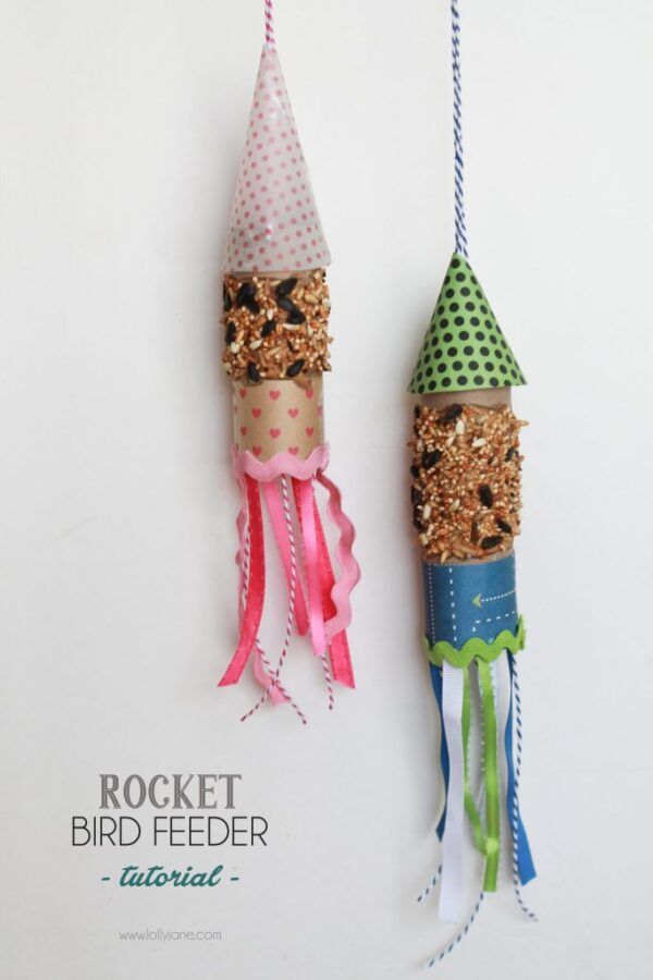 DIY rocket bird feeder... made from scrapbook paper and a toilet paper roll! Great kids craft!