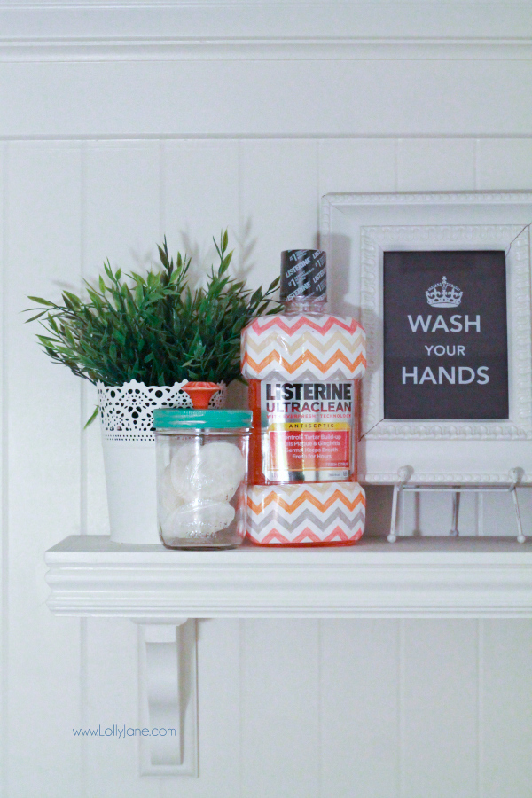Love this cute shelf in the bathroom. Click on this post for awesome storage ideas!