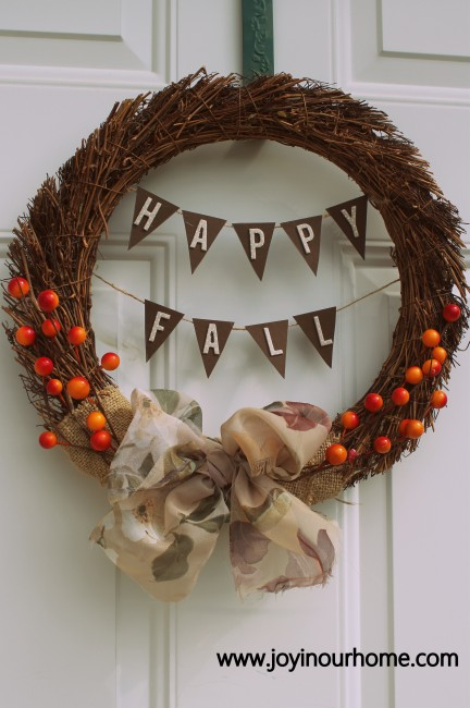 Such a cute diy fall wreath! We love this easy to make Happy Fall Wreath using a grapevine wreath form. This is a simple fall wreath using card stock, burlap and berry sprigs, cute! #diy #falldecor #fallwreath #wreath #wreathcraft #fallcraft #falldecoration #howtomakeafallwreath #wreathdecor