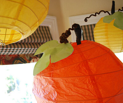 These paper lantern pumpkins are so easy to make with store bought paper lanterns! Such a cute fall craft idea! #paperlantern #pumpkincraft #paperlanternpumpkin #partydecor #fallparty #partyidea #pumpkincraft