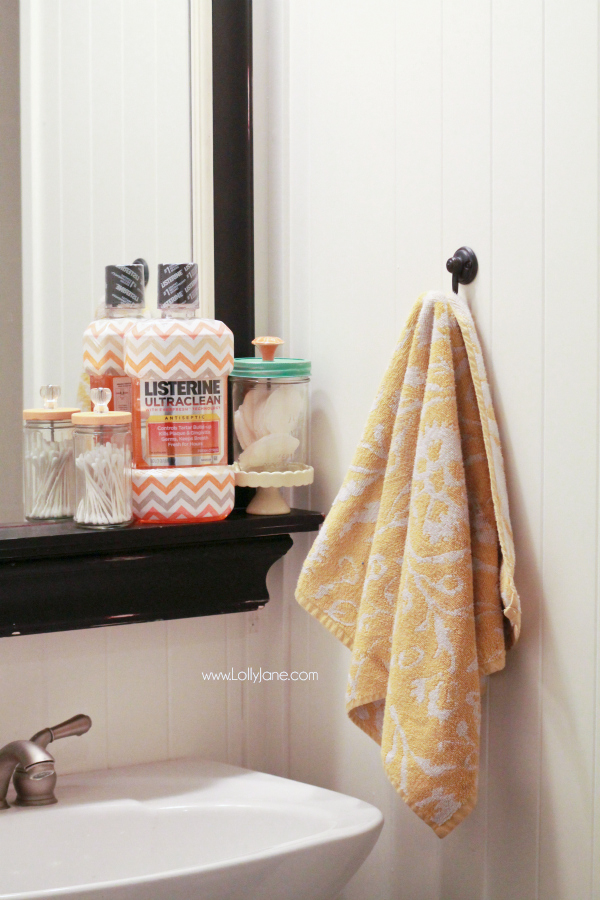Recycle old glass jars by adding knobs to use as pretty bathroom storage!