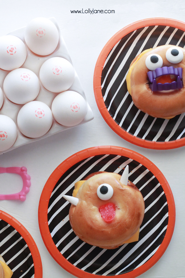 Monster Breakfast Bagel! Eggs inside are dyed bright colors + decorated like monsters- fun for a Halloween breakfast!