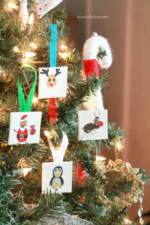 ADORABLE mini canvas thumbprint ornaments! SO EASY to make, kids have fun crafting and you get a Christmas keepsake for years to come. Great Christmas kids craft and Christmas gift idea!
