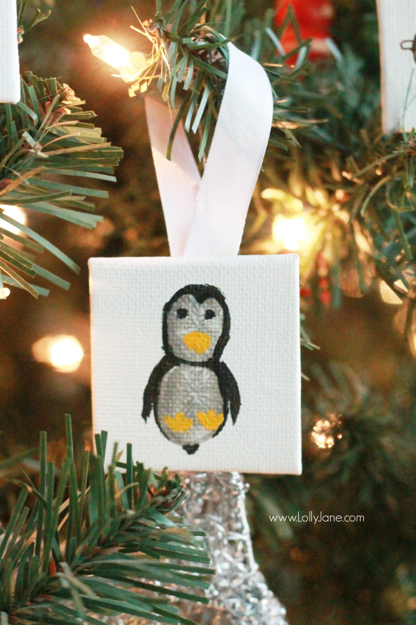 ADORABLE mini canvas thumbprint ornaments! SO EASY to make, kids have fun crafting and you get a Christmas keepsake for years to come. Great Christmas kids craft and Christmas gift idea! Love this penguin thumbprint ornament!