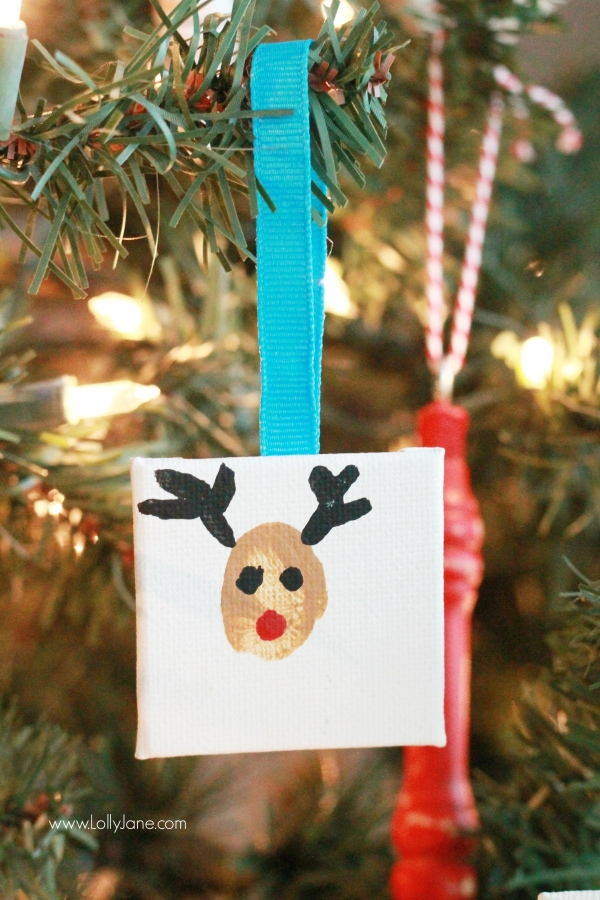ADORABLE mini canvas thumbprint ornaments! SO EASY to make, kids have fun crafting and you get a Christmas keepsake for years to come. Great Christmas kids craft and Christmas gift idea! Love this reindeer thumbprint ornament!