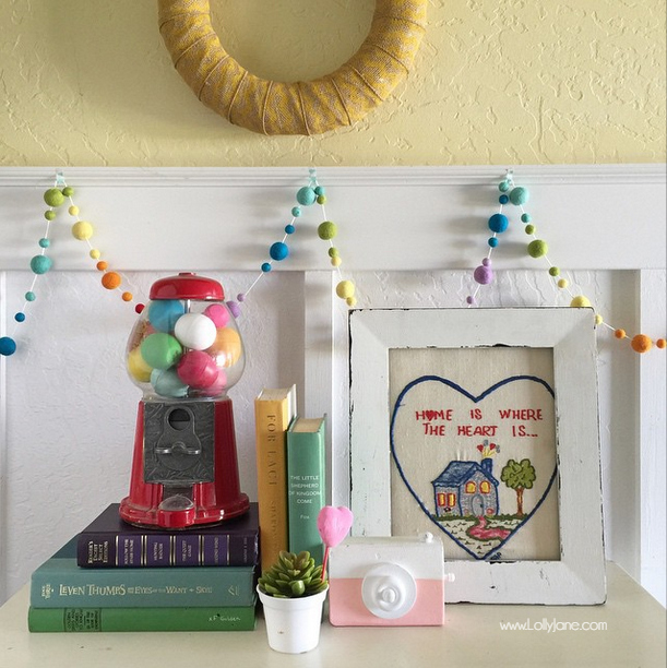 Fun rainbow entryway, lots of fun colors! Look at the gumball machine, they're EOS lip balms, lol! srcset=
