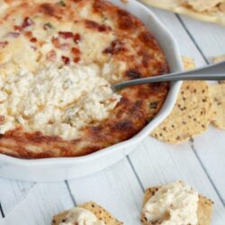 Four cheese hot artichoke dip recipe. The best dip recipe out there! Must try artichoke dip recipe!! Great side dish recipe and a fun Cinco de Mayo party dish!