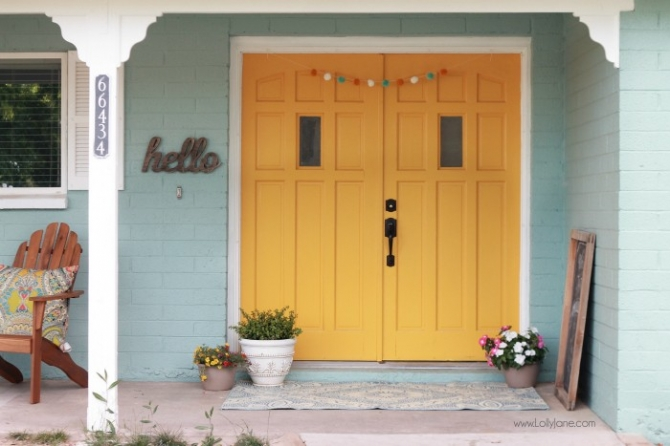 Freshly painted blue house with a mustard yellow door, before and after! Fun house color scheme reveal!