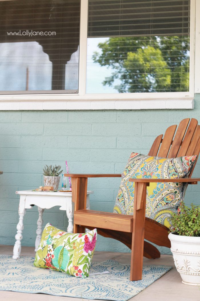 Colorful front porch tips, lots of pretty decor ideas by layering textures and patterns.