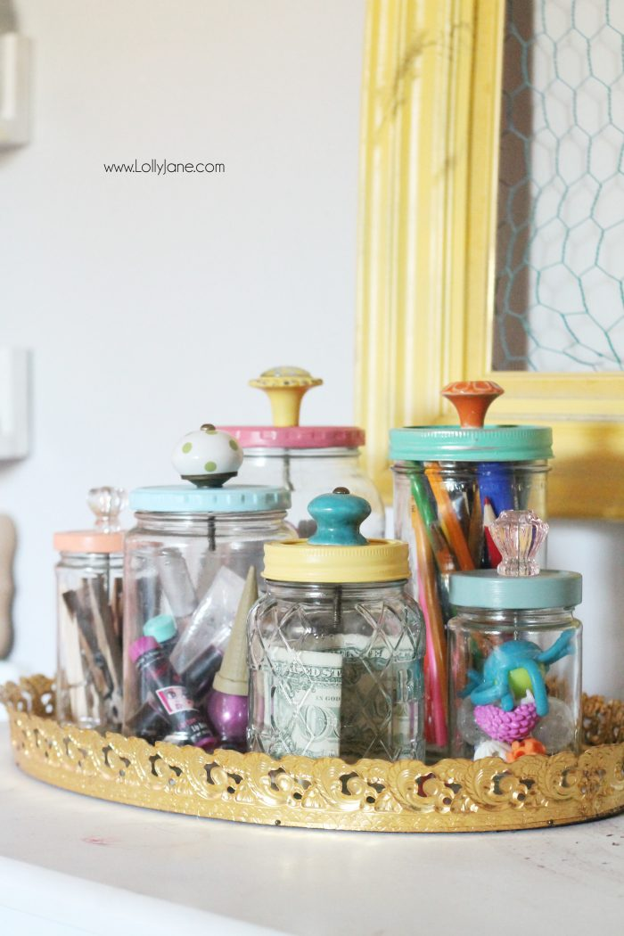 Add pretty knobs to the tops of mason jars for pretty mason jar storage solutions! Lots of options with this easy mason jar trick! Love these recycled food jars turned pretty storage jars with glass knobs!