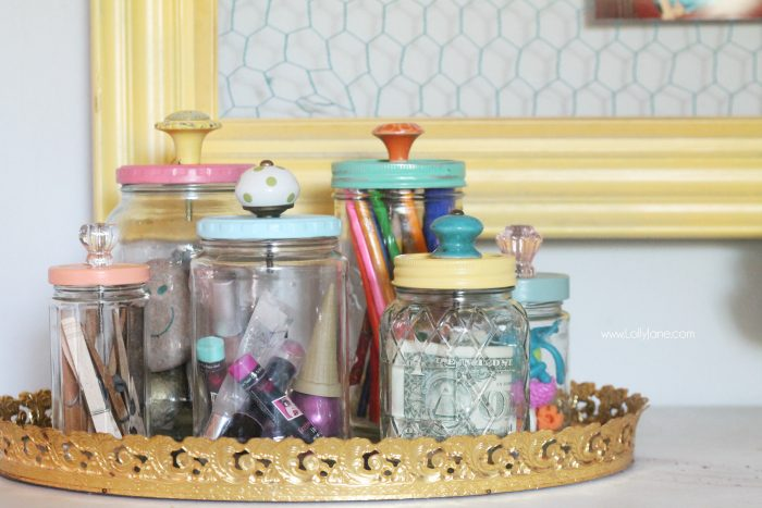 Add pretty knobs to the tops of mason jars for pretty mason jar storage solutions! & recycled food jars turned storage jars with glass knob tops
