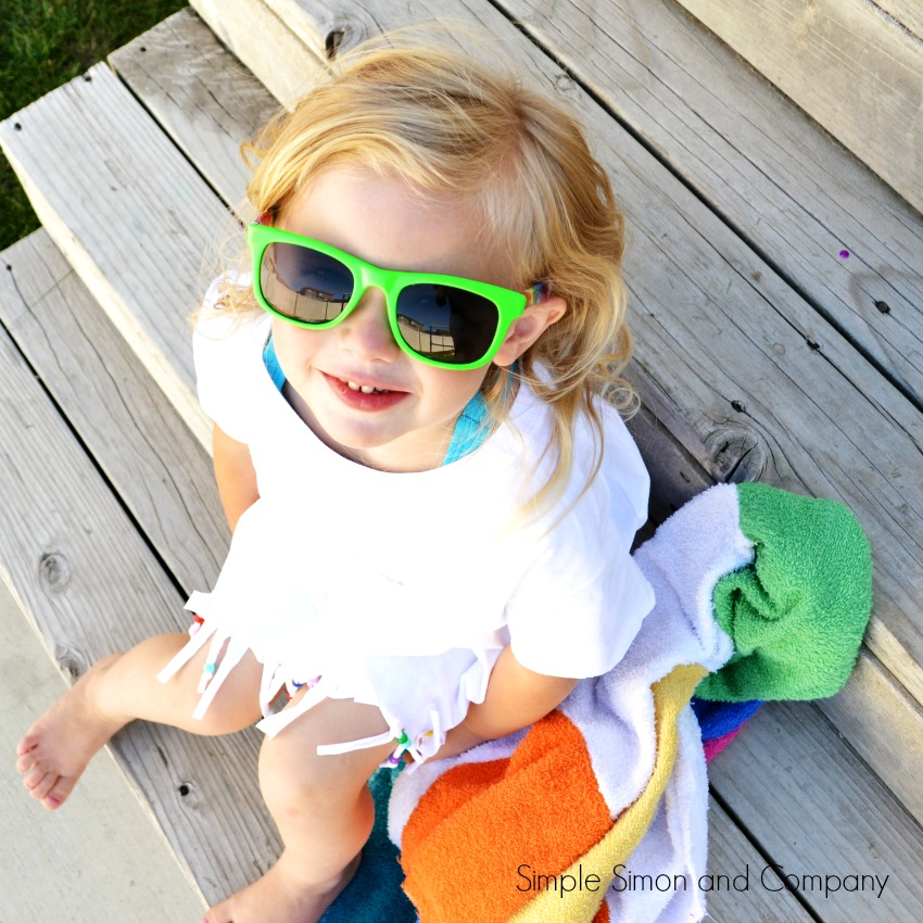 Make this no sew swimsuit cover up from a tee shirt! Just cut and add embellishments, so cute! Easy sewing tutorial, fun summer project idea, cute kids craft to work on!
