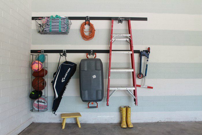 Garage organization solutions! Love the Rubbermaid FastTrack! Screw, attach, lock! Attractive garage organization ideas!