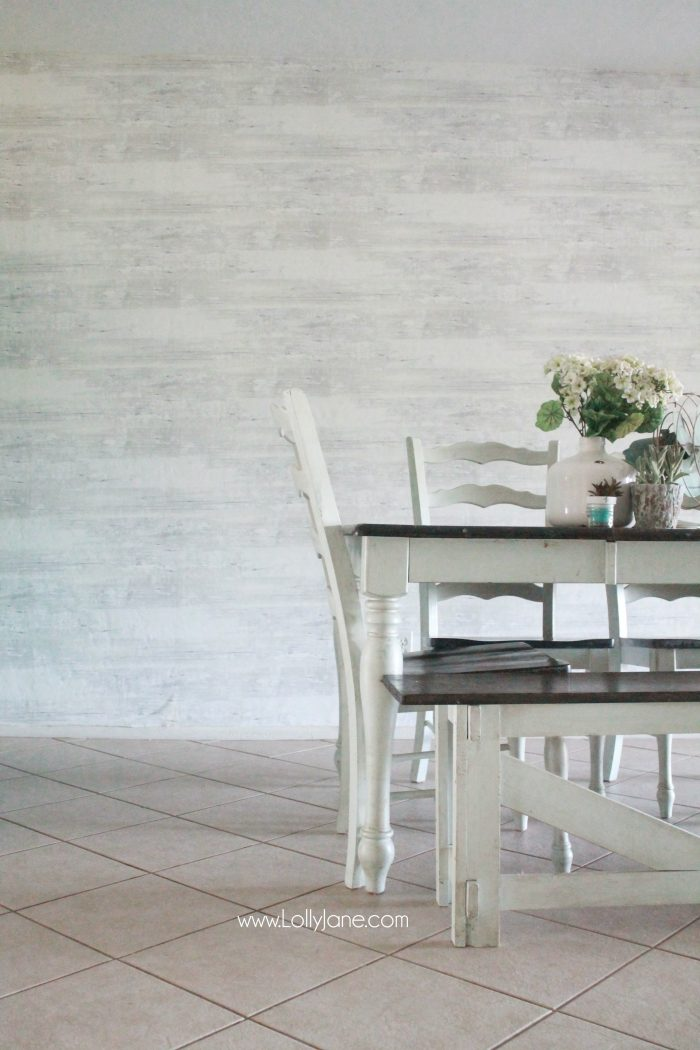 Faux wood wallpaper from Walls Republic, a fast alternative to shiplap or planked walls. Looks so good in this farmhouse dining room! Come see the full before/after room reveal!
