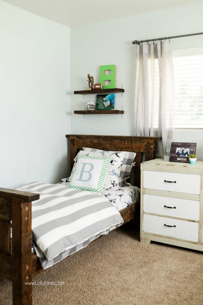 Vintage Industrial Boys Bedroom. Lots of wood tones, grays and neutrals for a vintage industrial boys bedroom. Cute decor ideas and tips to keep it neat. Fun accessories like a basketball hoop and green lockers to complete the space.