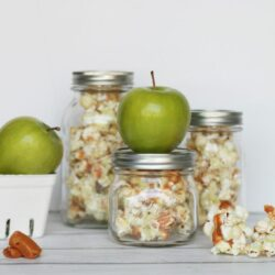 candied caramel apple popcorn in a jar