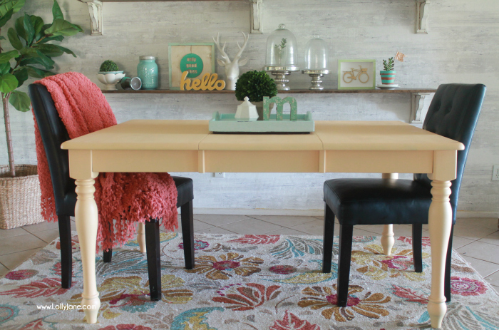 Love this colorful farmhouse dining room! Lots of color with classic pieces. This apricot dining room table is a fun way to bring color to a neutral space! Learn how to get a professional finish on your furniture!