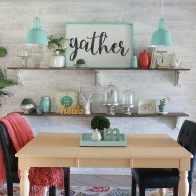 spraying a table with Glidden Premium