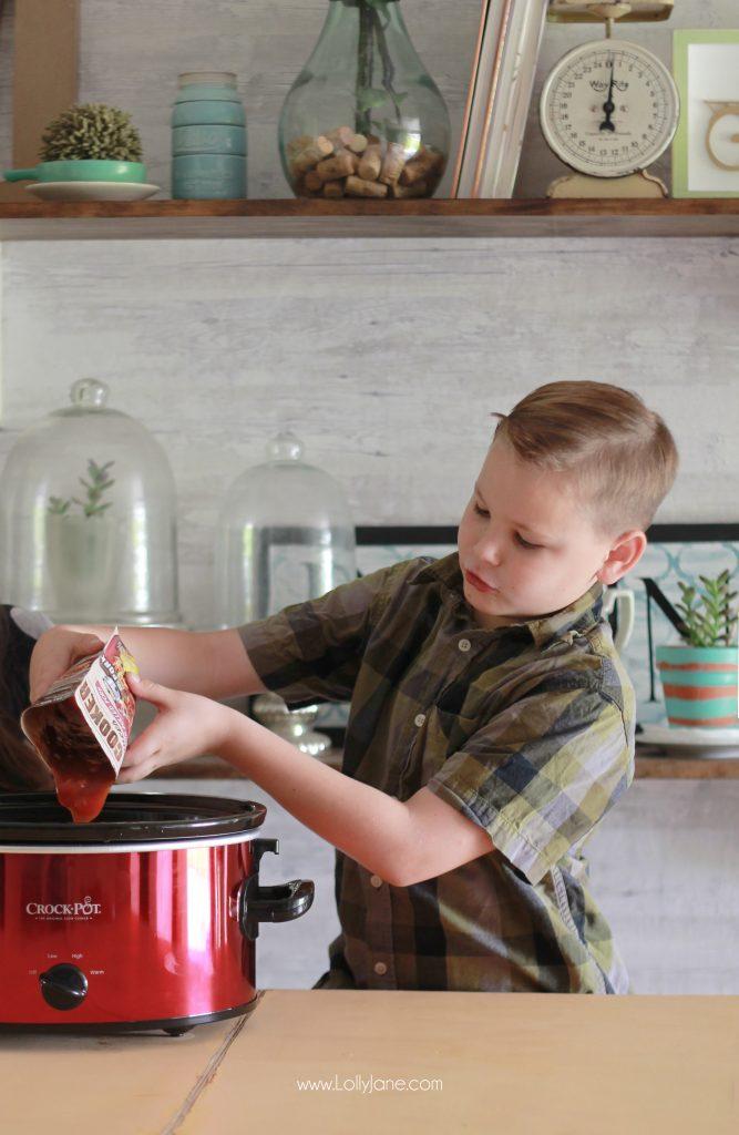Easy Crock Pot Apple Bourbon Pulled Pork... just toss ingredients in the crockpot, shred then sandwich in a bun! YUM!