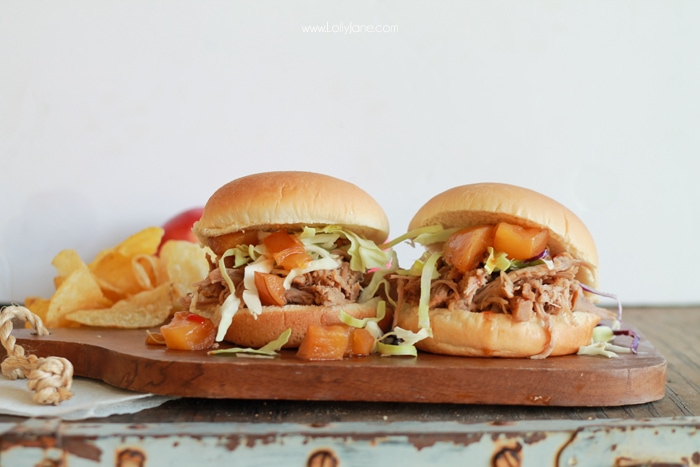 Easy Crock Pot Apple Bourbon Pulled Pork... just toss ingredients in the crockpot, shred then sandwich in a bun! YUM!