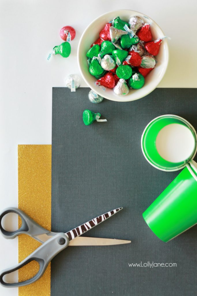 "Check out this cute Christmas gift idea, elf kisses treat idea, just fill a green cup with holiday Hershey kisses and tape on an ""elf belt"" so fun! Cute Christmas neighbor gift idea or cute Christmas craft idea!"