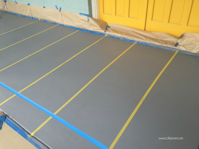 How to paint concrete floors: use a concrete paint porch and floor paint for secure adhesion. Click through for an awesome striped porch makeover.