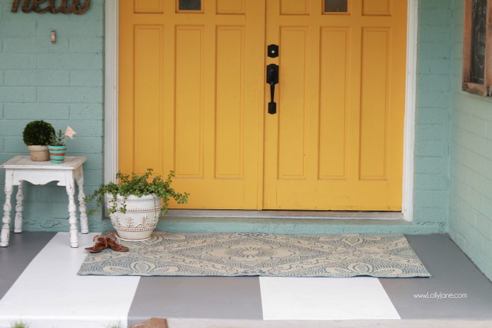 DIY painted striped concrete flooring. Check out this cute gray and white striped porch, easy way to freshen up your porch! Cute front porch decor!